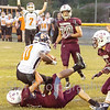 Star Photo/Larry N. Souders<br /> J.I. Burton's Tyree Bollings (10) scores the Black Raiders first touchdown of the night powering over Unaka's Payton Simpson.