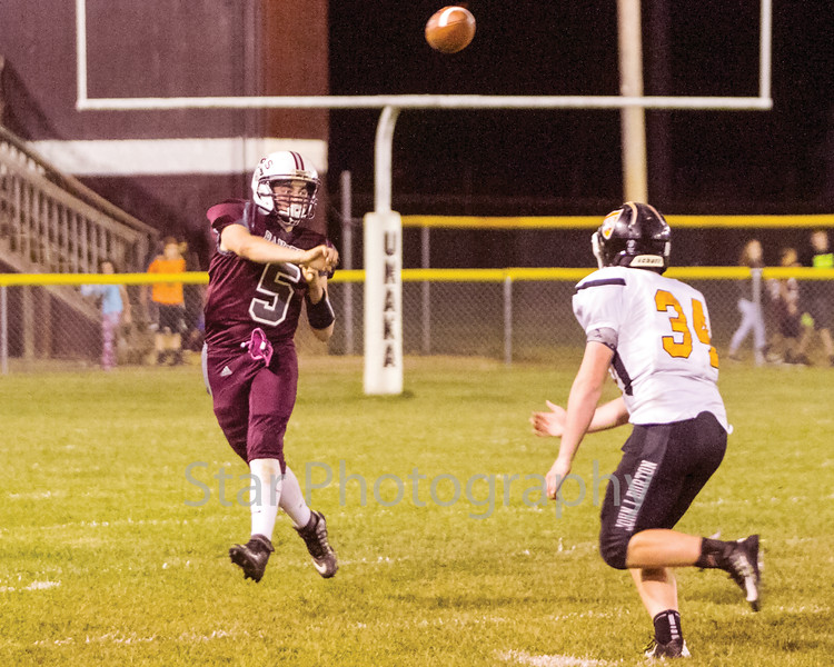 Star Photo/Larry N. Souders<br /> Ranger quarterback Blake King (5) moves outside of the pocket before firing a down field pass in the second quarter against the Black Raiders from J I Burton.