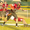 Star Photo/Larry N. Souders<br /> Ranger's running back (20) tries to escape a defenders  from Johnson County.