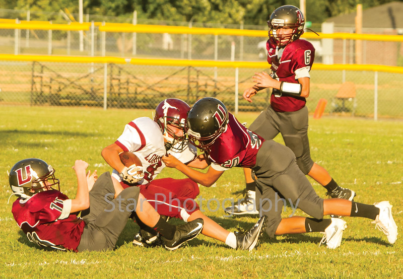 Star Photo/Larry N. Souders<br /> A running back (9) from Johnson Co. drags a few Rangers defenders along as he tries to get first down yardage.