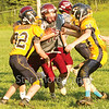 Star Photo/Larry N. Souders<br /> Happy Valley's running back (12) tries to split a pair of Highlander defenders.