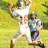 Star Photo/Larry N. Souders<br /> A Ranger wide receiver (16) shows off his good hands as he catches this over the shoulder pass for a touchdown.
