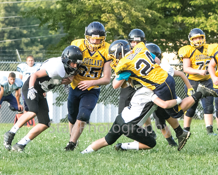 Star Photo/Larry N. Souders<br /> A pair Highlander (24) running back powers his way through a Chucky Doak defender.