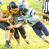 Star Photo/Larry N. Souders<br /> Two Bulldog defenders stop Cloudland's running back for little gain.