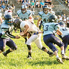 Star Photo/Larry N. Souders<br /> A swarm of Bulldogs' surrounds and tackles a Ranger running back.