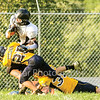 Star Photo/Larry N. Souders<br /> A pair of Highlander (25 & 35) chase down and knock a Black Knight running back (2) out of bounds saving a touchdown.