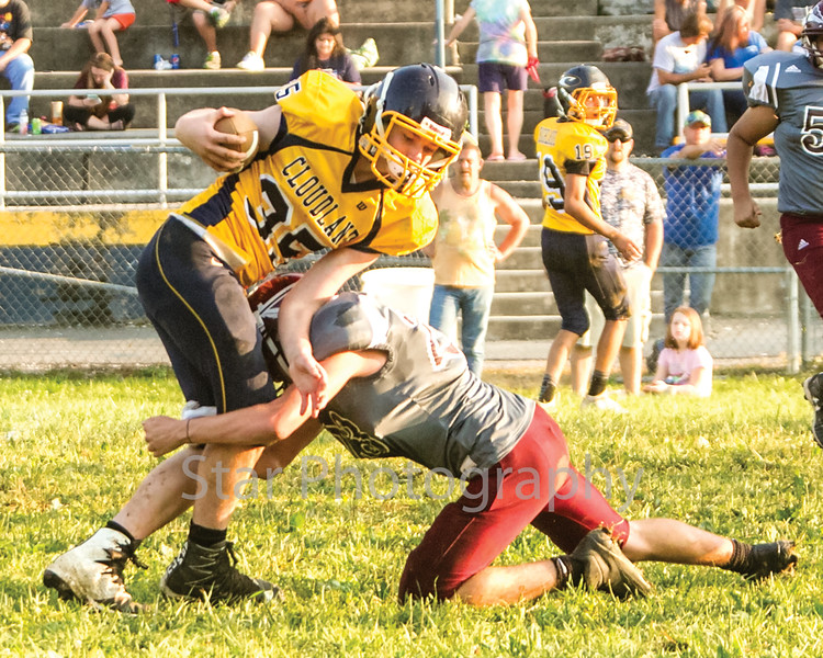 Star Photo/Larry N. Souders<br /> Cloudland's running back (35) is stopped behind the line of scrimmage by (23) of Happy Valley.