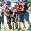 Star Photo/Bryce Phillips<br /> Jr. Cyclones Blake Stewart brings down a David Crockett running back.