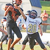 Star Photo/Bryce Phillips<br /> T.A. Dugger's Donta Earnest pulls in a pass.