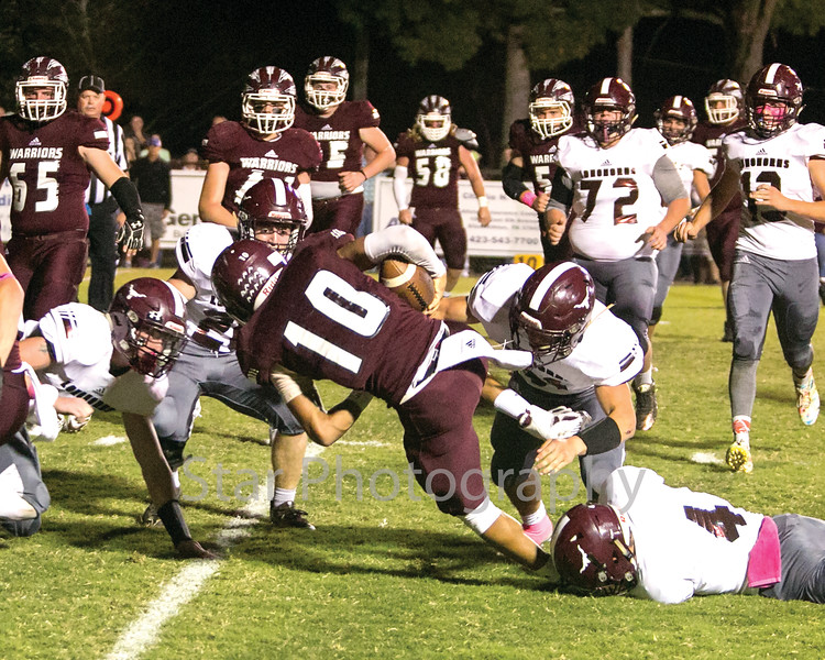 Star Photo/Larry N. Souders<br /> Happy Valley quarterback Brayden Sams (10) is stopped short of a first down by a host of Longhorn defenders.