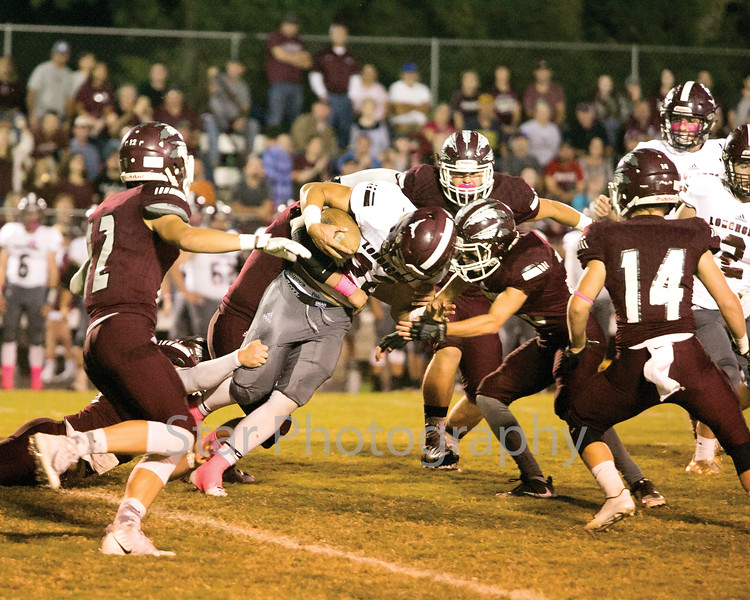 Star Photo/Larry N. Souders<br /> On the opening kickoff a swarming Warrior defense corrals Johnson County's Shane Greer (22) after a short return.