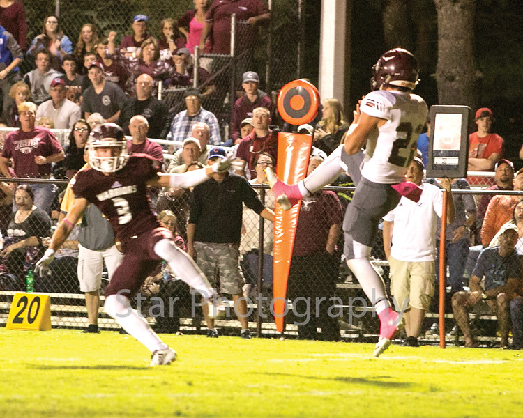 Star Photo/Larry N. Souders<br /> Warrior defense back Luke Phillips try to jump the route on a pass to Johnson County's Shane Greer (22), missing the ball by mere inches. Greer score an 18 touchdown on the play.