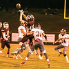 Star Photo/Larry N. Souders<br /> Longhorn defensive back Jimmy Bower (30) blasts  Happy Valley wide receiver Jacob Surcey (14) as he goes up for the catch.
