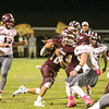 Star Photo/Larry N. Souders<br /> Happy Valley quarterback Brayden Sams (10) cuts back against the grain and scampers 39 yards for a first down.