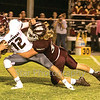 Star Photo/Larry N. Souders<br /> On the first play from scrimmage Happy Valley's Eli Fleenor (58) blew through the Longhorn line and sacks quarterback Nathan Arnold (12) for a nine yard loss.