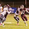 Star Photo/Larry N. Souders<br /> The Warrior's Matthew Bahn (22) take a swing pass and looks up field for running room.