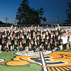 Star Photo/Larry N. Souders<br /> The Jr. Cyclones of T A Dugger's, celebrate a perfect season and a conference championship at midfield in Citizen Bank Stadium.