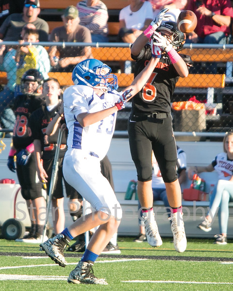 Star Photo/Larry N. Souders<br /> T A Dugger's Jake Roberts (6) breakup a pass intended for Vance's Logan Quales (13) almost making his third interception of the first half.