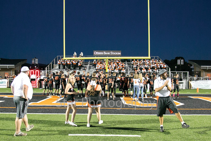 Star Photo/Larry N. Souders<br /> The Jr. Cyclones of T A Dugger's, celebrate their perfect season and a conference championship by singing the schools fight song in front of the Betsy band at Citizen Bank Stadium Tuesday night.