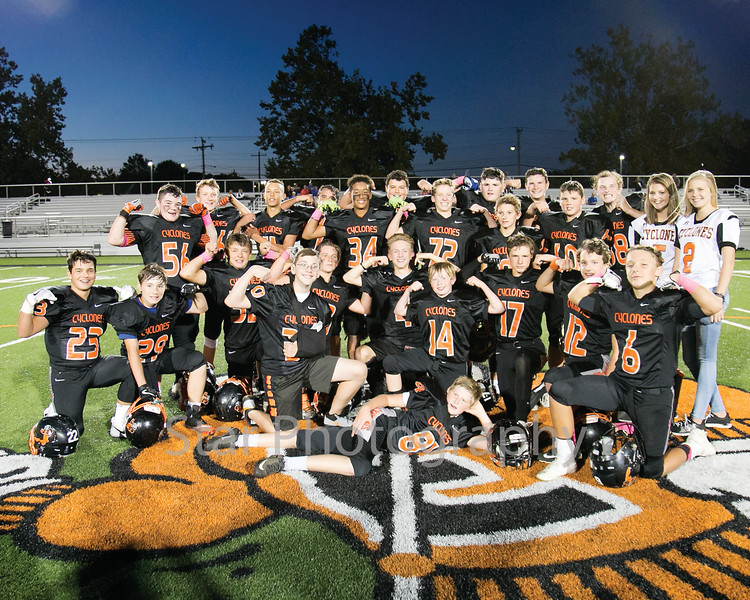 Star Photo/Larry N. Souders<br /> T A Dugger's eighth grade players celebrate a perfect season and a conference championship with a dominating win over the Vikings of Vance Middle School.