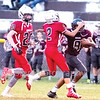 Star Photo/Larry N. Souders<br /> In the oddest play of the game a Rebel (20) from Cane River Middle School catches a punt, then hands the ball to Unaka's (9) who runs 20 yards for a Ranger first down.