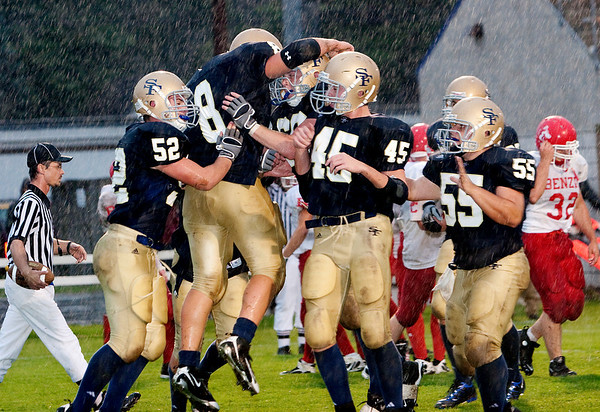 Record-Eagle/Douglas Tesner<br /> <br /> St Francis players celebrate after #8 makes a touchdown.