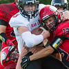 Record-Eagle/Brett A. Sommers Bear Lake running back Travis Johnson is brought down via gang tackle during Friday's football game against Suttons Bay. Suttons Bay won 61-20.