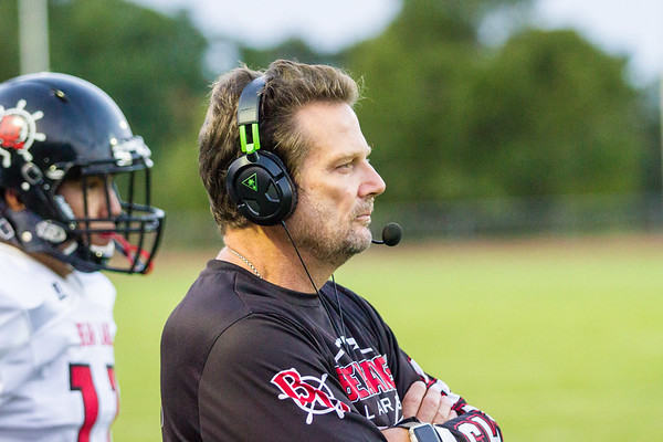 Record-Eagle/Brett A. Sommers Bear Lake coach John Prokes looks onto the field during Friday's loss to Suttons Bay.