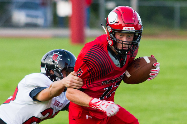 Record-Eagle/Brett A. Sommers Suttons Bay running back Bryce Opie breaks a tackle en route to a touchdown during a 61-20 win over Bear Lake on Friday.