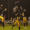 (Record-Eagle/John L. Russell) Cadillac's Graham Nelson leaps but can't quite grab this pass in the waning moments of the Sept. 26, 2003, game at Thirlby Field as Central's Greg Pinto (25) and Rudy Prokes defend.