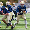 Record-Eagle/Brett A. Sommers Traverse City St. Francis' Joey Muzljakovich runs the ball during Saturday's pre-district playoff football. St. Francis won 28-6.