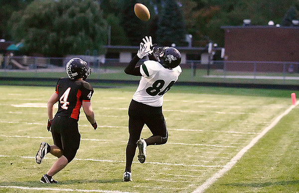 Record-Eagle/Keith King<br /> Grayling's Steven Enos makes a catch alongside Elk Rapids' Jason Baker Friday, October 1, 2010 at Elk Rapids High School.