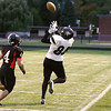 Record-Eagle/Keith King<br /> Grayling's Steven Enos makes a catch alongside Elk Rapids' Jason Baker Friday, October 1, 2010 at Elk Rapids High School.