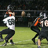 Record-Eagle/Keith King<br /> Grayling's Griffin Dean tackles Elk Rapids' Andrew Trautman Friday, October 1, 2010 at Elk Rapids High School.