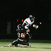Record-Eagle/Keith King<br /> Elk Rapids' Collin Wilcox tackles Grayling's Steven Enos Friday, October 1, 2010 at Elk Rapids High School.