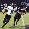 Record-Eagle/Keith King<br /> Grayling's Zach Wolcott tries to get past Elk Rapids' Collin Wilcox Friday, October 1, 2010 at Elk Rapids High School.