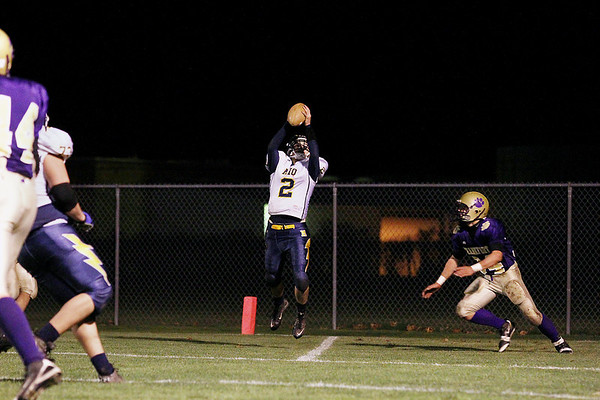 Record-Eagle/Keith King<br /> Mio's Micah Thomey catches the ball for a two-point conversion against Frankfort Friday, October 28, 2011 at Frankfort High School.