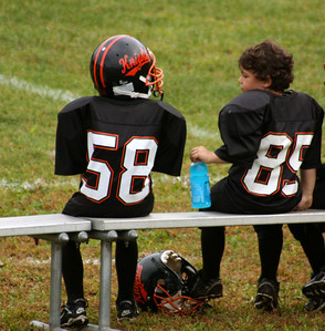 Dylan sitting next to Tim who is the smallest on the team.