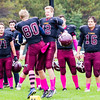 Record-Eagle/Brett A. Sommers Grand Traverse Academy tight end Addison Ortega (80) and Mitch Larkins (12) celebrate during pregame introductions before Saturday's game against Big Rapids Crossroads. GTA won 48-10.