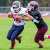Record-Eagle/Brett A. Sommers Grand Traverse Academy linebacker Conner Camp tries to bring down Big Rapids Crossroads running back Robert Penrod during Saturday's game. GTA won 48-10.