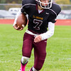Record-Eagle/Brett A. Sommers Grand Traverse Academy running back Justin Weeks carries the ball during Saturday's game against Big Rapids Crossroads. GTA won 48-10.