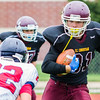 Record-Eagle/Brett A. Sommers Grand Traverse Academy's Carson Camp (81) eyes Big Rapids Crossroads would-be tackler Tyler Dennis (22) during Saturday's game. GTA won 48-10.