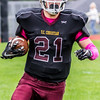Record-Eagle/Brett A. Sommers Grand Traverse Academy running back Corbin Lantzer hits the sideline for a touchdown run during Saturday's game against Big Rapids Crossroads. GTA won 48-10.
