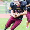 Record-Eagle/Brett A. Sommers Grand Traverse Academy's Connor Camp carries the ball during Saturday's game. GTA won 48-10.
