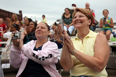 Akron resident Heidi Reid (left) and Sharon Inzetta, of North Canton cheer the spinning of a float at he Timken Grand Parade celebrating the Pro Football Hall of Fame induction ceremony on Saturday, August 8, in Canton. Ohio  By Lew Stamp, PhotoStamp@sbcglobal.net