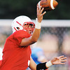 Globe/T. Rob Brown<br /> Seneca quarterback Payton Rawlins releases a pass during Friday night's jamboree, Aug. 23, 2013, at Webb City's field.