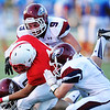 Globe/T. Rob Brown<br /> Joplin defenders Tristan Ash (9, above), Adam Norsworthy (6, right) and Josh Miller (80, left) bring down Seneca running back Dylan Snow during Friday evening's jamboree, Aug. 23, 2013, at Webb City's field.