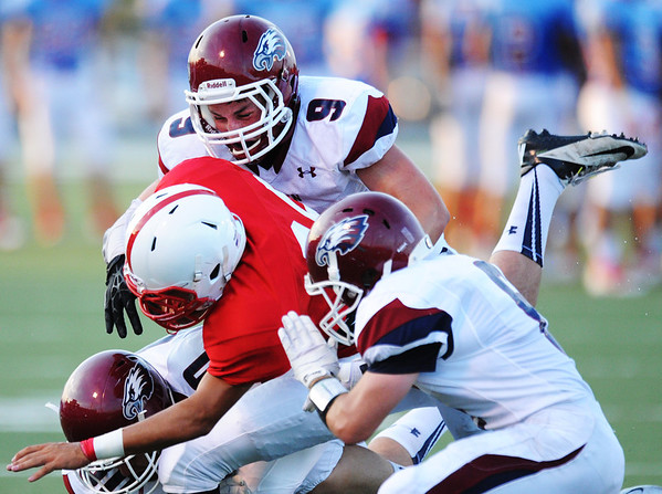 Globe/T. Rob Brown Joplin defenders Tristan Ash (9, above), Adam Norsworthy (6, right) and Josh Miller (80, left) bring down Seneca running back Dylan Snow during Friday evening's jamboree, Aug. 23, 2013, at Webb City's field.