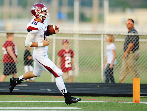 Globe/T. Rob Brown<br /> Joplin quarterback Skyler Duley scores a touchdown during Friday night's jamboree, Aug. 23, 2013, at Webb City's field.