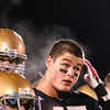 Record-Eagle/Jan-Michael Stump<br /> Traverse City St. Francis' Zach Swaffer (45) has steam rising from his head while watching the trophy presentation following Friday's district final win over Mancelona.